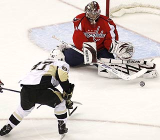 Rookie goalie Simeon Varlamov stops 34 shots, including this attempt by Sidney Crosby. (AP)