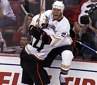 Todd Marchant celebrates his series-tying, game-winning goal with Rob Niedermayer.  (US Presswire)