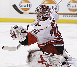 Cam Ward makes one of his 36 stops in his second playoff shutout in four games.  (AP)
