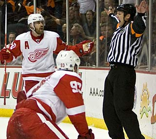 It's safe to say referee Brad Watson disappoints the Red Wings when he waves off the tying goal.  (AP)