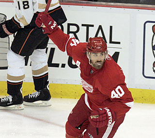 Henrik Zetterberg (goal, two assists) reacts after his Red Wings score in the second period.  (AP)