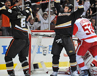 Teemu Selanne celebrates a goal by Ryan Getzlaf (right) that puts Anaheim on the board first.