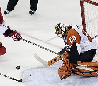 Ray Emery stops one of the 28 shots he faces in his Flyers debut.  (AP)