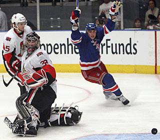 Brandon Dubinsky gets on the scoring sheet twice and gets an assist on Marian Gaborik's goal. (AP)