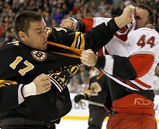 It's the tough guys! Milan Lucic gets the best of and bloodies Jay Harrison in a second-period fight. (AP)