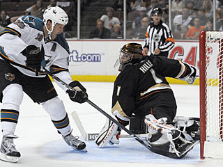 Joe Thornton puts the move on Jonas Hiller and finds the space to put the puck in the net. (AP)