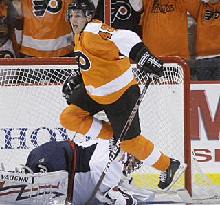 Danny Briere celebrates the winner after collecting a loose puck and shoving the rebound in the net. (AP)