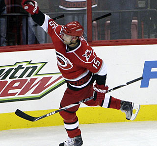 Tuomo Ruutu punches the air after beating goalie Mike Smith for the final goal in the shootout. (AP)