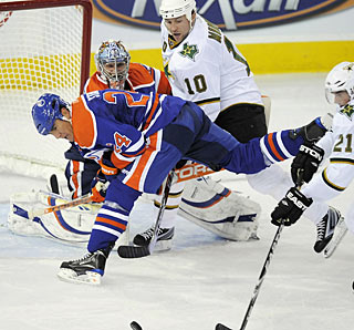 Nikolai Khabibulin's first regular-season win in an Oilers uniform also is his 300th career win. (AP)