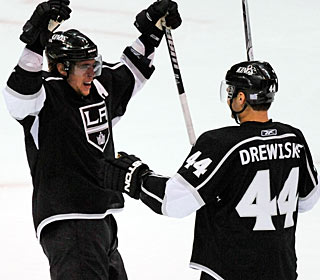Davis Drewiske scores his first NHL goal, yet Anze Kopitar seems to be more excited.  (Getty Images)