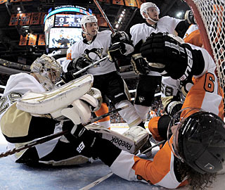 Marc-Andre Fleury is run into by Scott Hartnell (19) but does not let the puck past the line. (Getty Images)