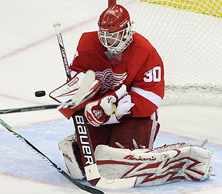 Chris Osgood makes one of 32 saves as the Red Wings knock off their division rivals.  (US Presswire)