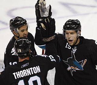 It doesn't take long for Dany Heatley (right) to have fans chant his name -- three goals will do that. (AP)
