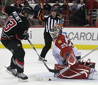 Ray Whitney scores Carolina's fourth straight goal, his first of the season. (AP)
