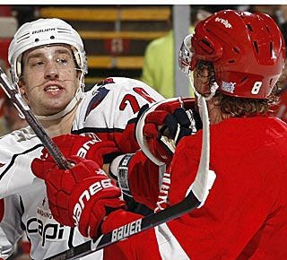 Washington's Shaone Morrisonn gets into a bit of a shoving match with Justin Abdelkader. (Getty Images)