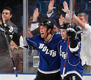 Ryan Malone enjoys his 2nd goal with Steven Stamkos before completing the hat trick. (Getty Images)