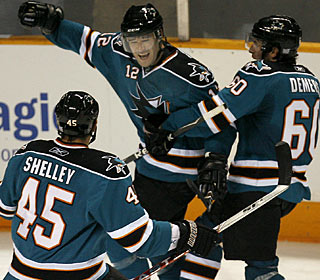 While Dany Heatley gets credit for the winner, Patrick Marleau makes his contribution with two goals. (AP)