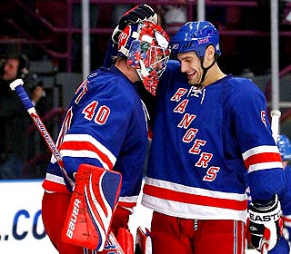 Backup goalie Steve Valiquette gets kudos from Dan Girardi after shutting out the Ducks. (Getty Images)