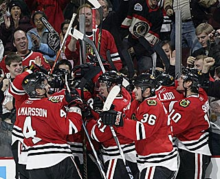 A crowd that was booing the Blackhawks in the first period erupts after the winning goal.  (Getty Images)