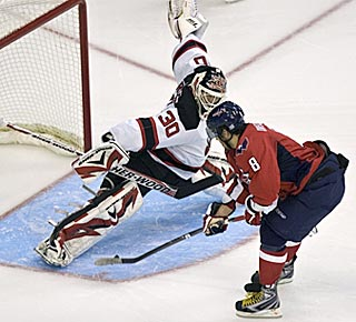 In a dream shootout matchup, Martin Brodeur gets the better of scoring champ Alex Ovechkin.  (AP)