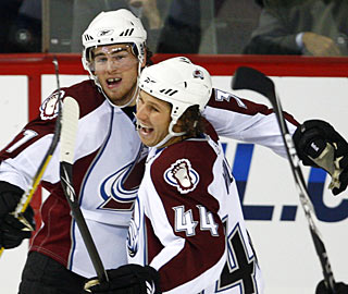 Ryan O'Reilly (left) couldn't be more happy with his first NHL goal, which turns out to be the winner. (AP)