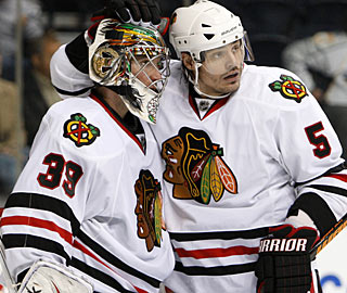 Brent Sopel (5) gives kudos to Cristobal Huet, who needs to stop just 12 shots for the win. (AP)