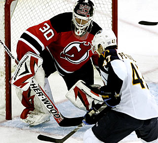 Rich Peverley gets the puck past Martin Brodeur two times on power-play action for Atlanta. (AP)