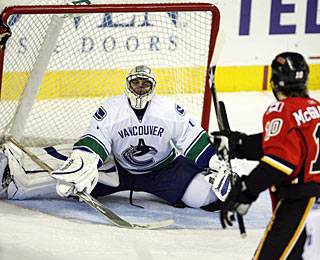 Roberto Luongo looks for answers, but he won't find them on this night as he is replaced. (AP)