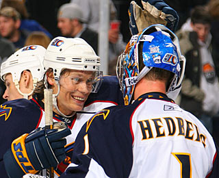 Maxim Afinogenov, who scores against his ex-team, celebrates with goalie Johan Hedberg. (Getty Images)