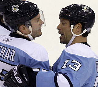 Sergei Gonchar (left) and Bill Guerin are loving life right now as the Penguins start the season fast.  (AP)