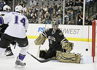 Justin Williams puts a shot past Marty Turco in the second period to put the Kings ahead to stay.  (AP)