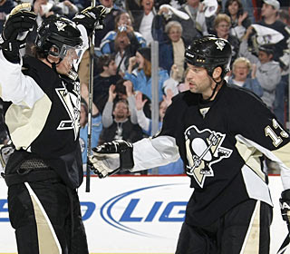Evgeni Malkin celebrates his fourth goal of the season with Bill Guerin, who sets up the play. (Getty Images)