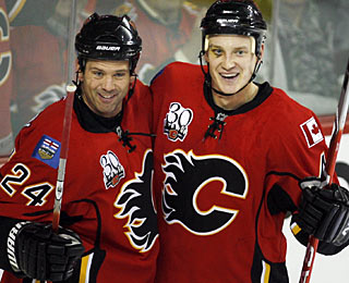 Jay Bouwmeester (right) celebrates his first goal in the regular season in a Flames uniform. (AP)