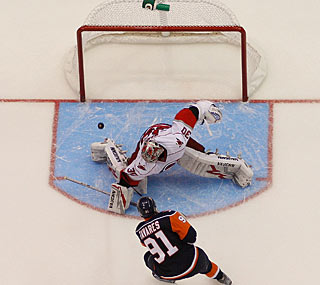 John Tavares goes right to left, beating Cam Ward to the stick-side. (Getty Images)