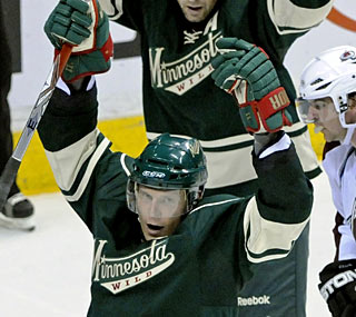 Newly-chosen captain Mikko Koivu enjoys his tying goal and later also scores in the shootout. (AP)