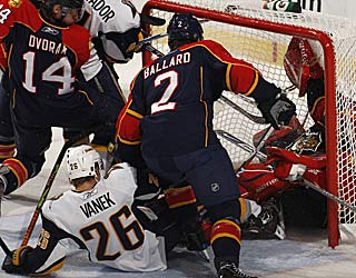 Thomas Vanek puts the puck, and the goalie, in the net for the Sabres' fifth goal. (Getty Images)