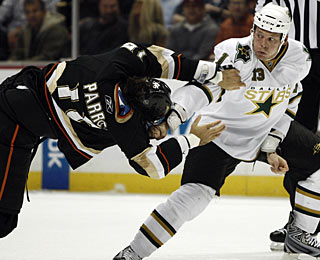 It looks like Krys Barch (right) is getting the better of George Parros in this first-period fight. (AP)