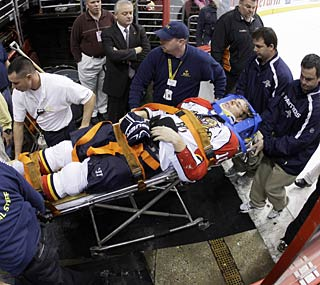 Florida's David Booth is taken off the ice on a stretcher after a hit from the Flyers' Mike Richards.  (AP)