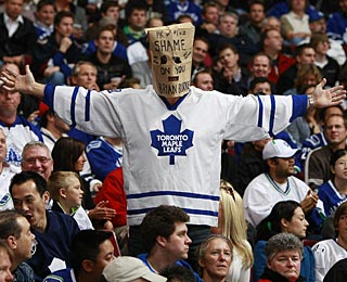 This Maple Leafs fan pretty much says it all about his team's woes to start the season. (Getty Images)