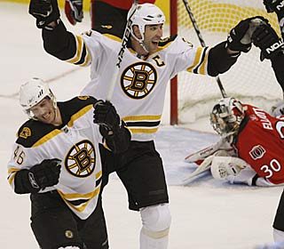 David Krejci (46) celebrates his game-tying goal with teammates as the Bruins rally for the win.  (AP)