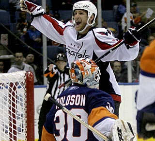 Brooks Laich celebrates after scoring the winner in the extra period, his fourth goal this season. (AP)