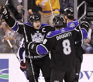 Dustin Brown (left) and Drew Doughty celebrate Michael Handzus' goal in the first period. (AP)