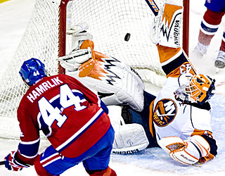Goalie Martin Biron is unable to stop Roman Hamrlik's shot, which gives the Canadiens the win in OT.  (AP)