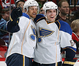 David Perron (right) celebrates his first goal before sealing the deal with an empty netter. (AP)