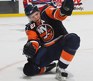 Kyle Okposo is pumped up after his power-play goal breaks the tie in the second period. (Getty Images)