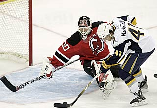 Clarke MacArthur slides a goal past the outstretched Martin Brodeur. (AP)
