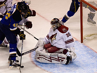 Ilya Bryzgalov denies David Backes from just outside the crease for one of his 32 saves. (Getty Images)
