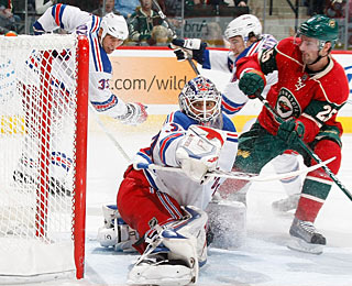 Eric Belanger (25) puts the puck past Henrik Lundqvist for his first goal in eight games. (AP)