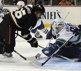 George Parros, usually stepping in for fights, scores a rare goal for the Ducks. (AP)
