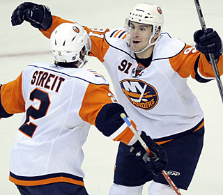Mark Streit celebrates his game-winning goal with teammate John Tavares. (AP)